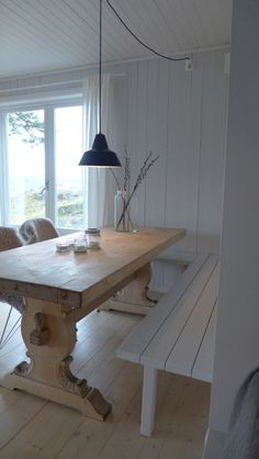 rustic dining area, wood white walls, antique table, built in seating