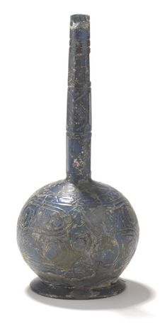 Ninth or tenth-century Iranian blue flask. Vessels such as this were made in large quantities both for the domestic and the export market and were traded as far east as China and Japan.