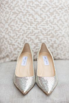 Stefanie walked down the aisle in sparkling shoes that featured a feminine pointed toe.  #sliver #metallic #flats #JimmyChoo Photography: Aaron Delesie Photographer