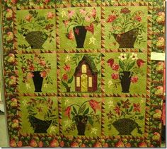 """Love, love love the colors in Shirley Mile's quilt, below.  The background fabric is hand dyed, and I think the color choice was stunning!  The quilt is called """"Baskets and Blooms in the Cottage Garden"""" pattern source from """"Quilting in the Garden.""""  The quilting was done by Suzie Berberich."""