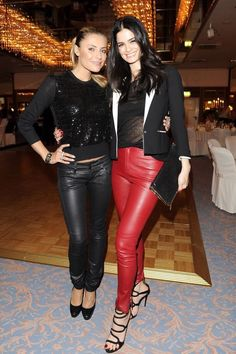 Girls in black and red leather pants