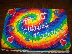 tie dye birthday - inside is rainbow cake with tie dye buttercream icing. :)
