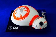 BB8 Droid Cake Cardiff Baker, Scrumptons Cakes and their incredible celebration cakes. There are cakes for every occasion including: anniversary, birthday, Easter, Halloween, Father's Day, Mother's Day, Valentines Day, Occasion Cakes, Graduation Cakes, Christmas Cakes. Subjects include: Cars, Star Wars, Dinosaurs, Animals, Harry Potter, Superheroes, Handbags, Basketball, Rugby Ball, Dr Who. Star Wars, Bb8, Christmas Cakes, Occasion Cakes, Cardiff, Celebration Cakes, Dinosaurs, Birthday Cakes, Rugby