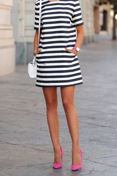 Striped shift dress with pockets and pink pumps with splash of color