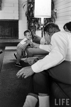 Steve McQueen at home with his wife and son.