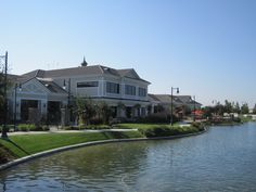 A freshwater lake and club house at Woodbridge by #DelWebb, an #activeadult community in Manteca, CA  https://www.55communitysearch.com/california/communities/woodbridge-by-del-webb