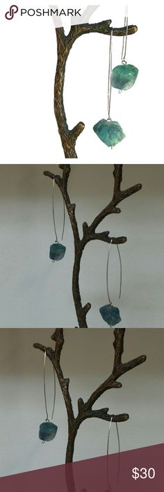 """Blue-green fluorite stainless steel earrings Gorgeous handmade stainless steel earrings with natural, blue-green fluorite gemstone nuggets.   They measure approximately 2 3/4"""" long, total. The gems themselves measure approximately 1/2"""" cubed.   I welcome offers :)  The earrings are handmade by me, however, I listed them under the Anthropologie brand because they seem to fit in nicely.   The earrings modeled are a different pair with larger stones. You will receive brand new, unworn earrings…"""
