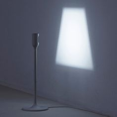 Tongue in Cheek Furniture 5 LED lamp projects its own screen on the wall.