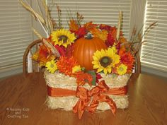 fall flower arrangements with hay  | Raising Kids and Crafting Too: Decorative Fall Hay Bale