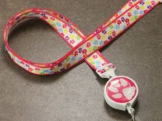 Pretty Little Paw Print Ribbon Lanyard  Somewhere over the rainbow … a whole bunch of teeny candy-colored dogs went and left teeny candy colored prints! If you wanna be there too, this lanyard is for you.