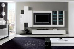 entertainment center with floating cabinets but with symmetrical shelves for the sides Pallet Entertainment Centers, Floating Entertainment Center, Modern Floating Shelves, Floating Cabinets, Wall Unit Designs, Living Room Tv Unit Designs, Space Saving Furniture, Furniture For Small Spaces, Furniture Ideas