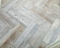 Timber Ash Glazed Porcelain Floor Tile, cut in half and laid in herringbone pattern. Going to do in bathroom. Lowes.