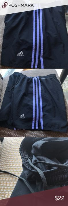 ADIDAS CLIMALITE WOMENS SHORT Adidas CLIMALITE Black with Purple Stripes and side slit. These are an older style Adidas Short and no longer available.  They were only worn a couple times and are in EXCELLENT/NEW CONDITION.  Elastic waist with drawstring.  Inside pocket. 🚫NO TRADES🚫 Adidas Shorts