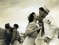 Sailor kisses his girl