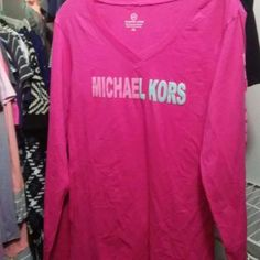 New Michael Kors Never worn New Authentic Micheal Kors T-shirt Long sleeve never worn....It is a nice soft pink color and size is XL but fits tight so if u wear a large you would be comfortable in this for a cold Night out MICHAEL Michael Kors Tops Tees - Long Sleeve