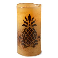Real wax-coated flameless pillar candle printed with primitive pineapple is made to look aged for a true rustic feel.