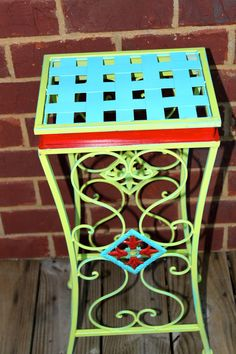 Plant stand /Side Table... Metal. Green Red Aqua, Colorful, Flower, Painted, Bright, Decorative, Chic, Patio Furniture. $40.00, via Etsy.