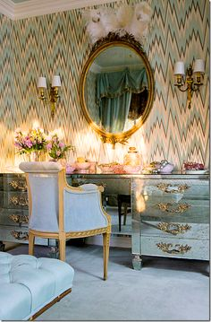 Mirrored vanity antique sconces and velvet chair