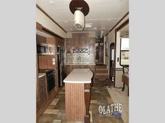 2016 New Heartland Oakmont 345RS Fifth Wheel in Kansas KS.Recreational Vehicle, rv, 2016 Heartland Oakmont 345RS, Enjoy camping in this Oakmont fifth wheel by Heartland RV. Inside model 345RS you will find triple slides for increased floor space, and a kitchen island, plus more.As you enter notice the counter straight ahead with storage above and a double sink. The slide adjacent features two pantries, a refrigerator, and three burner range, plus overhead storage. This slide out also…