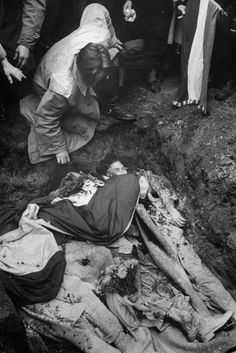 <strong>Not published in LIFE.</strong> Burying the dead, Hungary, 1956.