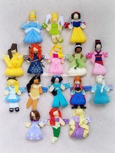Sixteen lovely ladies, ribbon sculptures that I designed. Can be attached to hair clips or played with as a little doll. Find this and more on my FB page. Hair Clips All Colors Hair Clips With Rubber Grip Ribbon Art, Ribbon Crafts, Princess Hair Bows, Disney Princess, Disney Hair Bows, Diy And Crafts, Crafts For Kids, Ribbon Sculpture, Ribbon Hair Bows