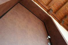 Detail of the aluminum-Corten coating in this reinforced front door.