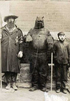 Either really bad Halloween costumes or the guy in the middle was just executed....Whatever, Halloween Fun to the Max!