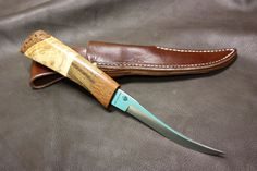A personal favorite from my Etsy shop https://www.etsy.com/listing/269786853/trapper-fur-taker-filet-knife-with