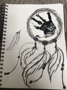 My sons handprint and my charcoal sketch of a dreamcatcher! ❤️ perfection.
