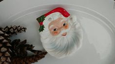 Check out this item in my Etsy shop https://www.etsy.com/listing/258822376/kitsch-santa-claus-spoon-rest-or-holiday