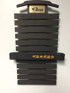 This beautiful one-of-a kind,modern handmade martial art belt display rack is made of cabinet grade oak plywood slats are made of Baltic Birch 6 pile Plywood, with a personalized gold name plate at no charge. These belt displays are really cool and kids love them. Its a great gift. I began making these for family and friends when I was unable to find belt racks of sufficient quality to meet my needs. I now also make them for martial arts schools, including my own. This belt display will…