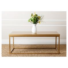 """• Wood table top with iron leg frame painted gold<br>• Rectangle shape<br><br>Add interest to your space with the Maplewood Antiqued Wood Coffee Table - Gold - Abbyson Living. Perfect for your living room – this table exudes modern elegance with sharp lines and a gold finish. 18.5""""Hx42""""Wx22""""D"""