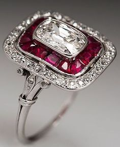 Art Deco Heirloom Diamond Ring - This magnificent Art Deco ring features a stunning natural carat antique cushion cut diamond center stone surrounded by a halo of lab created ruby accents and a second halo of natural diamonds. Art Deco Ring, Art Deco Jewelry, Jewelry Design, Art Deco Schmuck, Schmuck Design, Ruby Jewelry, Fine Jewelry, Tiffany Jewelry, Silver Jewelry