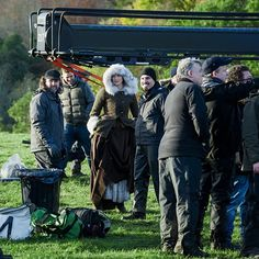 Behind the scenes picture of Caitriona Balfe on the set of Outlander. All hands on deck on the set plus Matt Roberts and Ron Moore.