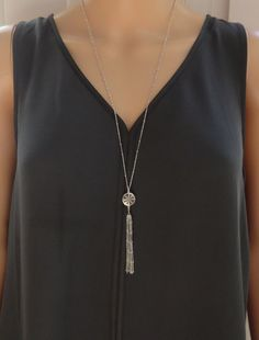 A personal favorite from my Etsy shop https://www.etsy.com/listing/476359431/silver-tassel-necklace-long-silver