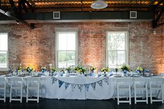 Love the head table we did for this wedding! Used cobalt blue, white milk glass, blue and white chinoiserie floral vessels and blue and white vintage china. Dixie Does Vintage Rentals