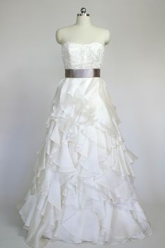Playful silk organza gown with a dramatic ruffled skirt by Jim Hjelm