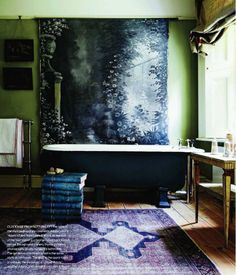 I love this bathroom! tapestry on wall, footed tub, dressing table, antique rug via: bathroom102411 01