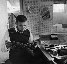 Jan Gunnarsson, the chief engineer for offshore pirate radio station Radio Caroline, reads a copy of 'Pop Weekly' on board ship off the Suffolk coast, April 1964.