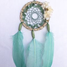 A personal favorite from my Etsy shop https://www.etsy.com/listing/233254799/small-mint-green-floral-dream-catcher