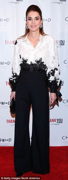 Queen Rania of Jordan in an embellished white shirt and black pants in New York in Septemb...