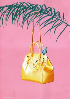 The Gold Soft Ricky Bag is ready for a vacation in the December issue of L'Officiel Paris