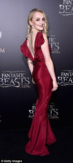Red hot! Harry Potter actressEvanna Lynch, 25, smouldered in a figure-hugging deep burgundy gown
