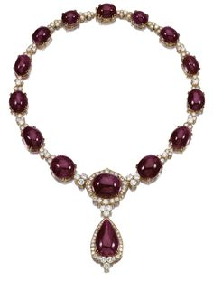 RUBY AND DIAMOND NECKLACE.  Designed as a series of graduated cabochon rubies connected by clusters of circular- and brilliant-cut diamonds, suspending a pendant centring on a pear-shaped cabochon ruby within a border of circular- and brilliant-cut diamonds, length approximately 460mm, French assay marks.