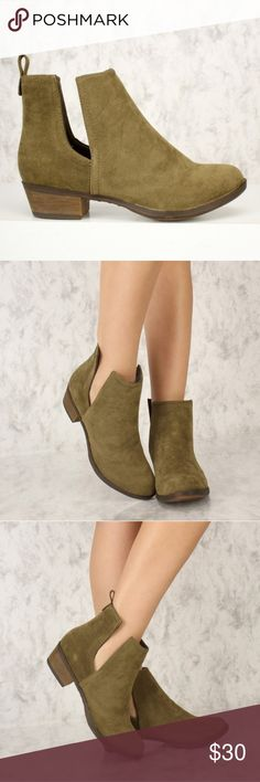 Olive Green Booties Olive green booties with stylish slit on sides. Fits true to size with room for socks. Shoes Ankle Boots & Booties