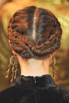 Pin for Later: 22 Lazy-Girl Braids For Summer Reverse Milkmaid Braids Reverse milkmaid braids, like these at Christian Siriano, are a hot trend that can easily jazz up any style.