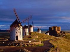 Consuegra, Spain with Windmills and La Muela Castle in the background. Was there and saw a re-enactment of Don Quixote attacking the windmill.  It was fabulous.