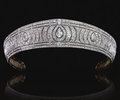 A DIAMOND KOKOSHNIK TIARA, CIRCA 1910.  Designed as a series of radiating scrolls surrounding three principle pear-shaped diamonds set with circular-, rose-cut and cushion-shaped stones, framed by two lines of similarly-set diamonds,  inner circumference approximately 380mm, fitted case by Harman& Co Ltd & Lambert, 177 New Bond Street.