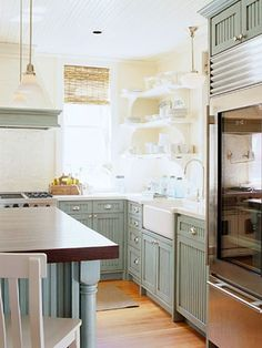 Love the table legs on the island and the cupboards