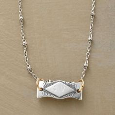 """Handcrafted to recall Victorian jewels, delicate cartouche I.D. tags are flanked by scrolled etchings and suspended from 14kt goldfill jump rings. Cultured freshwater pearls at lobster clasps. Made in USA of sterling silver. Personalized with up to three uppercase block initials (letters only, no special characters or symbols). 16""""L, 5/8"""" x 1/4"""" tag."""